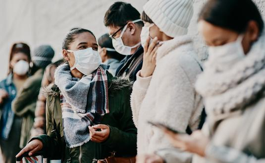 A group wearing face masks amid the COVID-19 pandemic