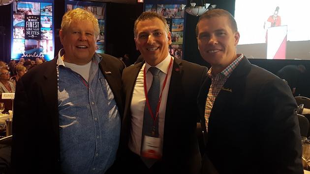 Gordon 'Butch' Stewart and Adam Stewart, flank Air Canada Vacations' managing director Nino Montagnese.