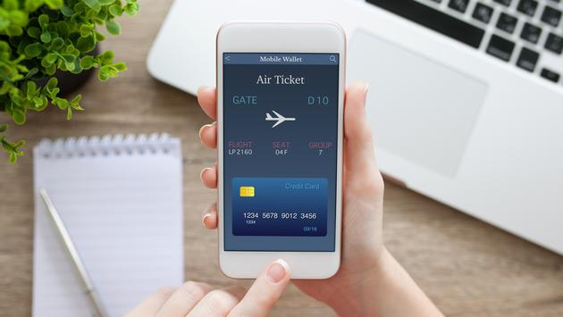 Mobile phone with online air ticket and notebook.