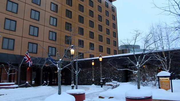 The snow covered entry of the Hotel Captain Cook in Anchorage