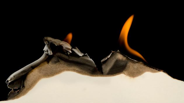Burning edge of paper