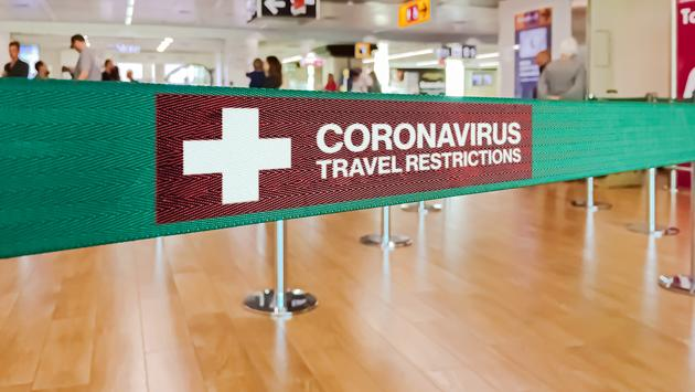 Coronavirus travel restrictions sign.