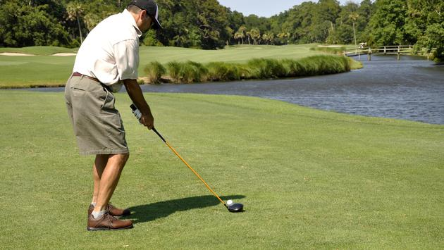 A man golfing at The Sea Pines Resort in Hilton Head Island, South Carolina