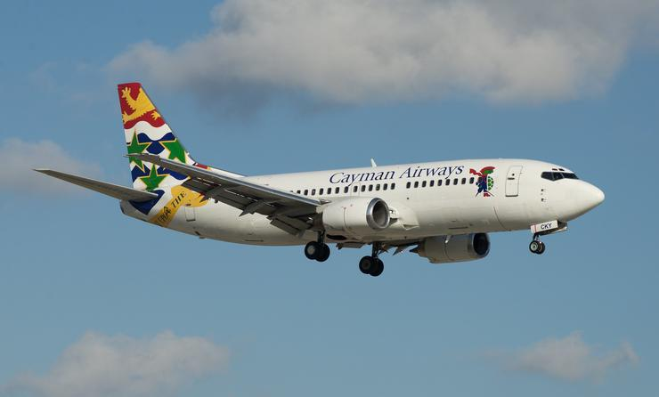 Cayman Airways plane on approach to the runway