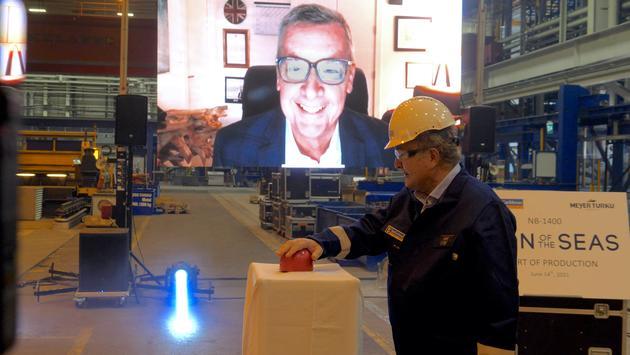 Michael Bayley on video screen