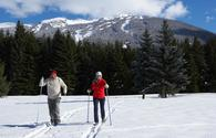 Man and woman skiing in Whistler, British Columbia