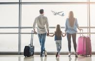 Family in airport (Photo via Vasyl Dolmatov / iStock / Getty Images Plus)