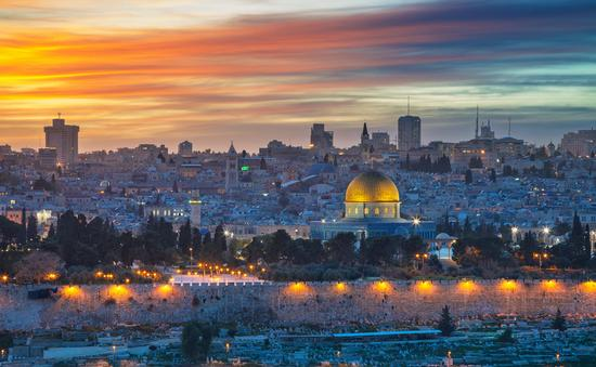Cityscape image of Jerusalem, Israel with Dome of the Rock at sunset.