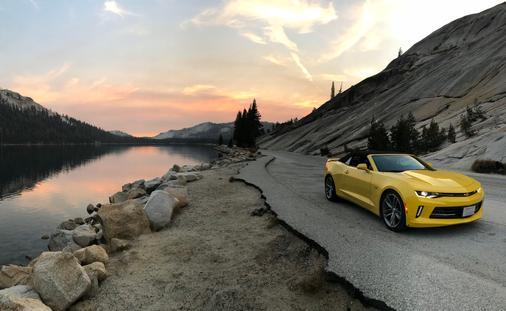 A Chevrolet Camaro Convertible driving through Yosemite Valley