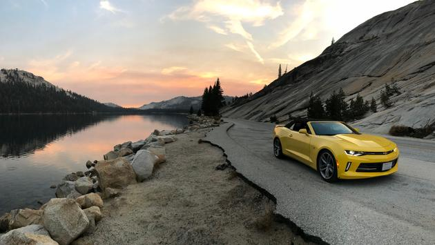 A Chevrolet Camaro Convertible driving through Yosemite Valley