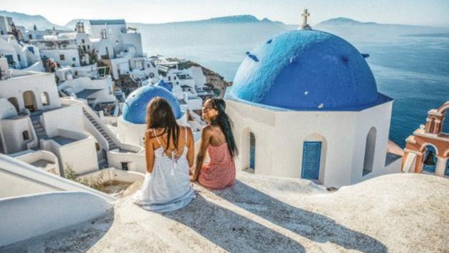 Two women enjoying Greece on a Contiki trip.