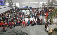 Passengers at the check-in counters inside of Ninoy Aquino International Airport in Manila, Philippines