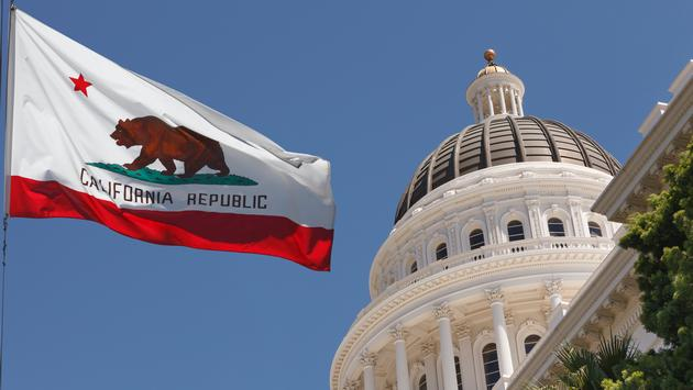California's state flag waving outside the Capitol Building in Sacramento.