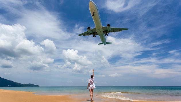 Plane approaching Phuket International Airport at Mai Khao Beach