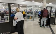 Travelers check in with TSA at Atlanta Airport