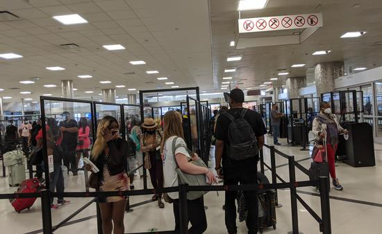Travelers waiting in security line