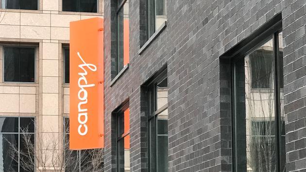 Orange canopy sign at Canopy by Hilton Atlanta Hotel