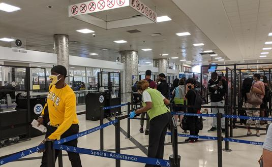 Travelers waiting in the security line at the airport
