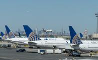 United Airlines planes parked at gates at Newark Liberty International Airport