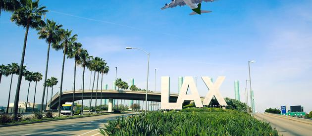 A plane flies above Los Angeles International Airport, LAX