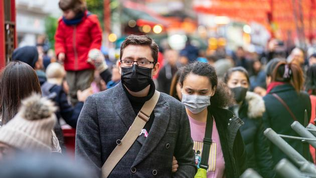 Travelers wearing masks amid the coronavirus outbreak in China