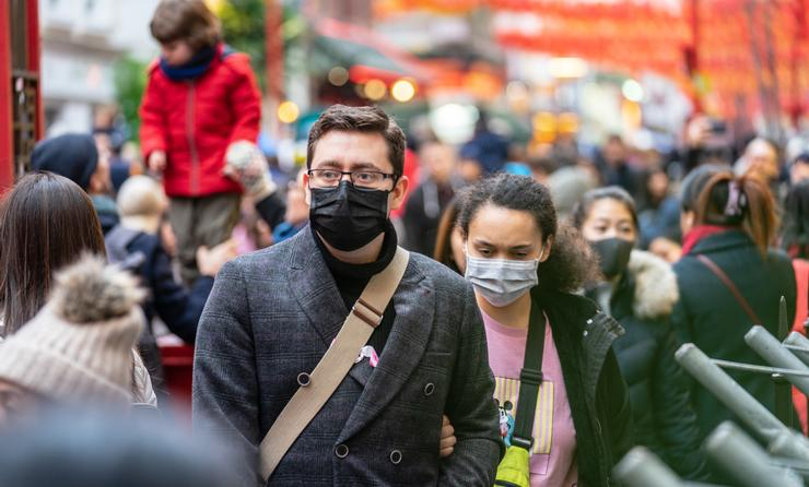 Travelers wearing masks amid the coronavirus outbreak in China