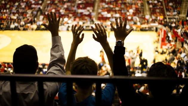 Crowd cheering on a basketball game