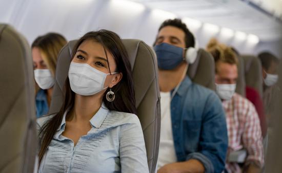 People wearing masks on a flight