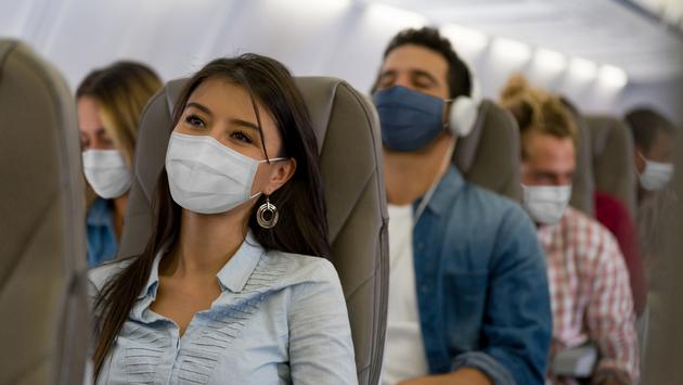 People wearing masks on a flight