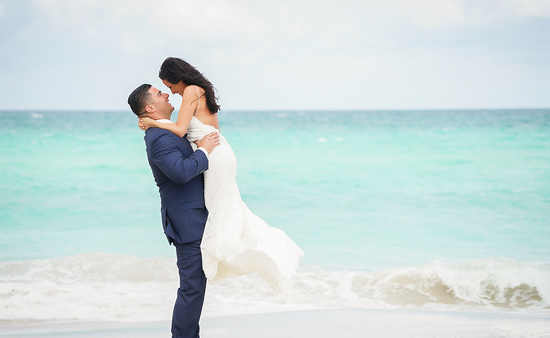 A couple celebrating a wedding at Trump International Beach Resort