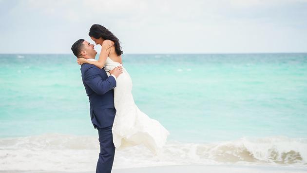 A couple celebrating a wedding at Trump International Beach Resort