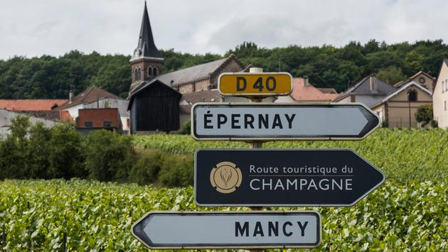 Epernay: Sign of the Route Touristique du Champagne with in the background vineyards of the Champagne district Vallee de Marne, France.
