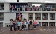 CruiseOne/Dream Vacations travel agents on the Mekong River.