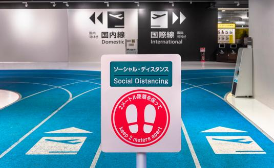 Social distancing sign at Airport in Tokyo, Japan.