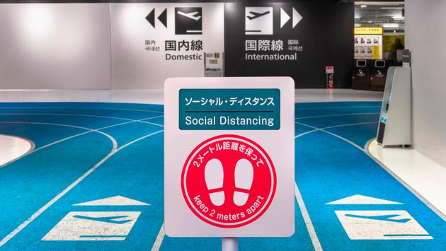 Social distancing sign at Airport in Tokyo, Japan.
