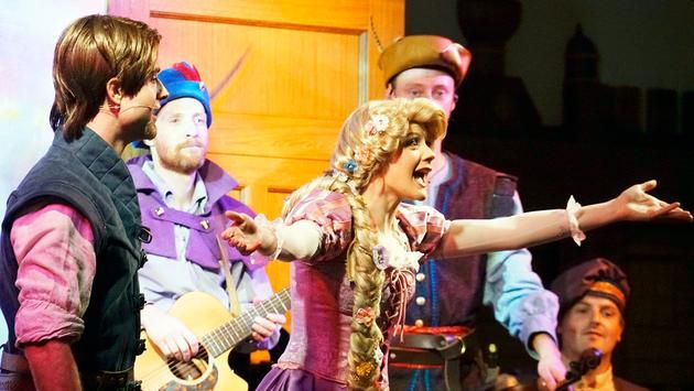 Rapunzel and Flynn Rider celebrate at Rapunzel's Royal Table on Disney Cruise Line's Disney Magic