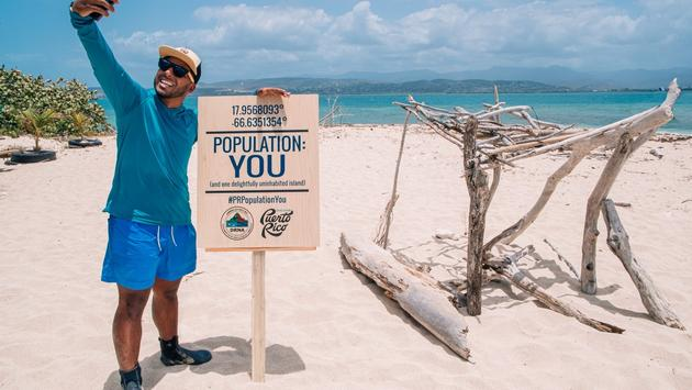 Man taking a photo at Cayo Cardona, part of the Population: YOU campaign
