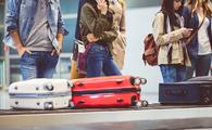 travelers waiting at airport