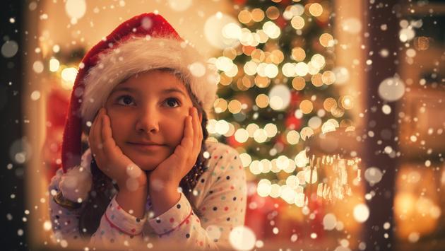 A little girl waiting for Santa on Christmas Eve.