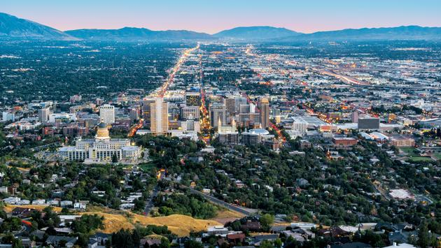 Salt Lake City's downtown landmarks illuminated at dusk.