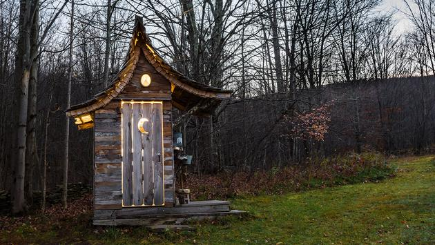 Glamping Outhouse (Photo via JasonOndreicka / iStock / Getty Images Plus)