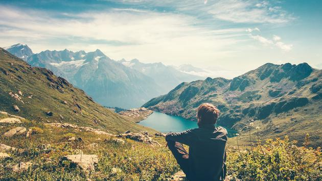A Thinking Traveler Enjoys a Nice View of the Mountains