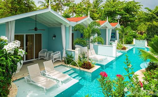 Up to $635 Instant Credit: Beachfront Crystal Lagoon Swim-up Butler Room w/ Patio Tranquility Soaking Tub