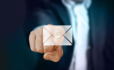 Businessman selecting email envelope