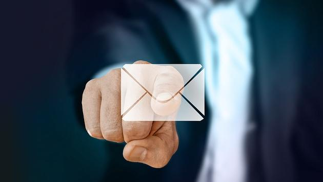 Businessman selecting email envelope