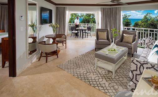 Up to $1,000 Instant Credit: Beachfront One Bedroom Butler Suite with Balcony Tranquility Soaking Tub