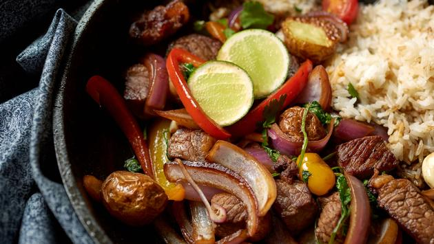 Lomo saltado or Peruvian stir fry combines marinated sirloin beef steak with rice.