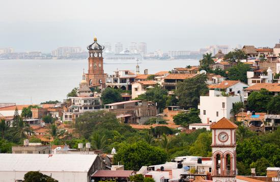 Downtown Puerto Vallarta with cruise ship in the background.