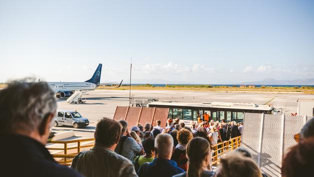 Tourists boarding a plane at Rhodes International Airport