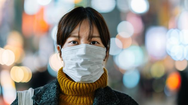 Young woman wearing a face mask in hopes to avoid contracting the coronavirus.